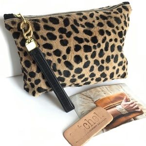 Auth. SATCHEL. Savannah Kay Fur Leopard Wristlet